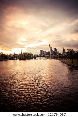 Frankfurt city before the rain. Vertical shot of the skyline in the city downtown - stock photo