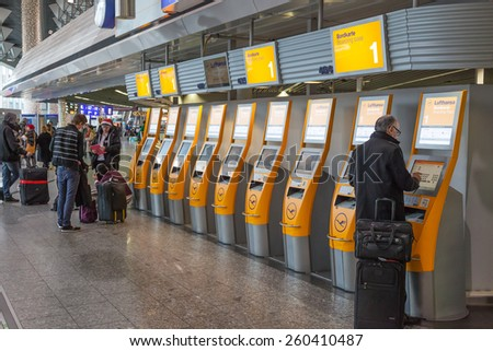 FRANKFURT - DEC 6: Lufthansa self checkin machines at the Frankfurt International Airport. December 6, 2014 in Frankfurt Main, Germany - stock photo