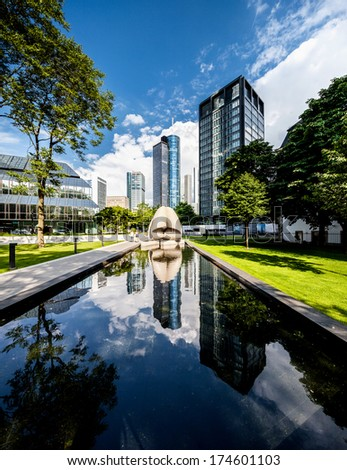 Frankfurt financial district reflecting in water - stock photo