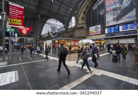 Frankfurt, Germany - April 30, 2014: Train travelers walk around among the kiosks in the central hall of Frankfurt railway station in Frankfurt, Germay on April 30, 2014 - stock photo