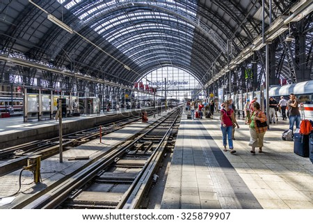 FRANKFURT, GERMANY- AUG 30, 2008: People arriving or departing at the Frankfurt main train station in Frankfurt, Germany. The station opened in 1888 as dead end station. - stock photo