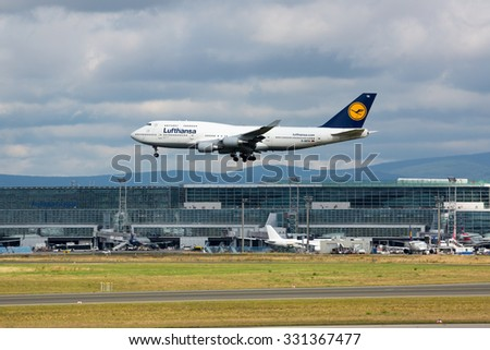 FRANKFURT,GERMANY-AUGUST 23: Boeing 747 (Jumbo Jet) LUFTHANSA over airport on August 23,2014 in Frankfurt,Germany. - stock photo