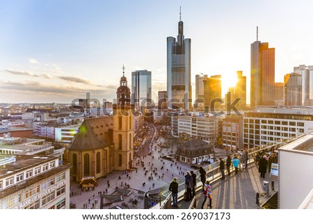 FRANKFURT, GERMANY - FEB 21, 2010: view to Hauptwache with Kathrin Church in sunset with skyscraper in Frankfurt, Germany. - stock photo