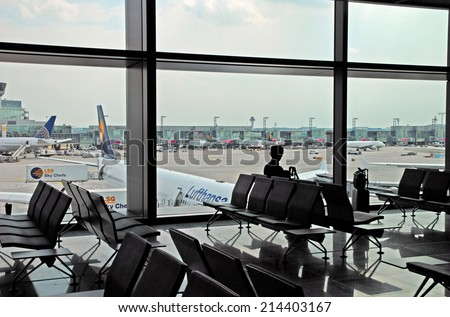 FRANKFURT, GERMANY-JULY 26, 2013: business man at the airport. With 38 million passengers per year it is one of the most important airport in Europe. - stock photo