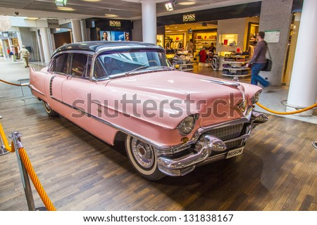 FRANKFURT, GERMANY - JUNE 8:  pink 1956 Cadillac at the airport on June 8, 2012 in Frankfurt, Germany. It belongs to the museum of Sinsheim with more than 1 Millon visitors per year. - stock photo