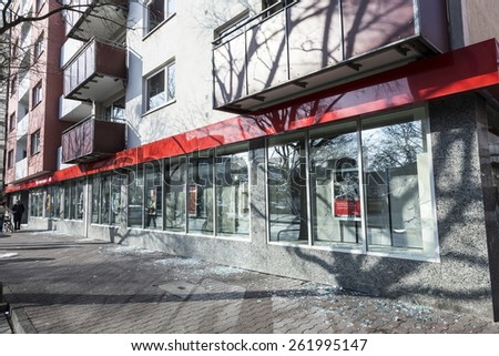 FRANKFURT, GERMANY - MAR 18, 2015: Demonstration against EZB and Capitalism in Frankfurt, Germany. Some people destroy windows and objects of a sparkasse, a German bank. - stock photo