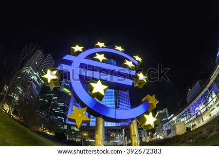 FRANKFURT, GERMANY - MAR 17, 2016: Illuminated buildings and Euro sign at night during Luminale  in Frankfurt, Germany. The Light festival takes place in Frankfurt every 2 years and lasts one week. - stock photo