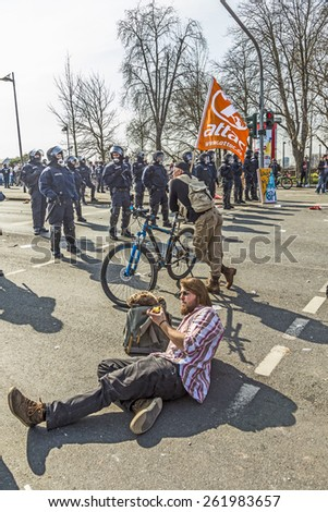 FRANKFURT, GERMANY - MAR 18, 2015: people demonstrate against EZB and Capitalism in Frankfurt, Germany. Man shows attac banner. - stock photo
