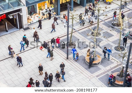 FRANKFURT, GERMANY- MARCH 1, 2014: People walking along the Zeil street in Frankfurt, Germany. The place is one of the most famous and busiest shopping streets in Germany. - stock photo