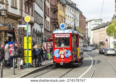 FRANKFURT, GERMANY - MAY 2, 2015: people enjoy the ride with the Ebbelwei express in Frankfurt, Germany, The Ebbelwei-Express is a touristic line established in 1977. - stock photo