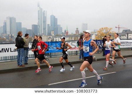 FRANKFURT, GERMANY - OCTOBER 30: Group of runners runs the BMW Frankfurt Marathon, October 30, 2011 in Frankfurt, Germany. - stock photo