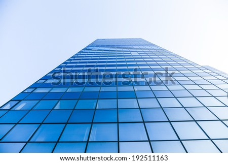 FRANKFURT, GERMANY - SEP 25: glass facade of Modern skyscraper on Sep 25, 2011 in Frankfurt, Germany. Frankfurt offers nowadays more space for office buildings than for living i the urban area. - stock photo