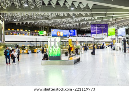 FRANKFURT, GERMANY - SEP 22, 2014: people at the Airport in the evening in Frankfurt, Germany. In 2012, Frankfurt handled 57.5 million passengers. - stock photo