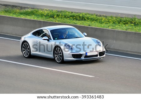FRANKFURT,GERMANY - SEPT 24:Porsche on the highway on September 24,2015 in Frankfurt, Germany.Porsche AG- German automobile manufacturer specializing in high-performance sports cars, SUVs and sedans. - stock photo