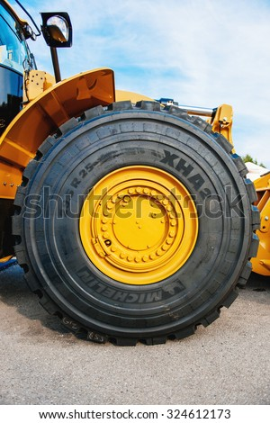 FRANKFURT, GERMANY - SEPTEMBER 05, 2014: Liebherr tractor with imense Michelin tire. Michelin is a tire manufacturer based in Clermont-Ferrand in the Auvergne region of France - stock photo