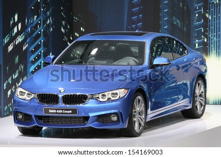 FRANKFURT - SEPT 10: BMW 435i 4er Coupe shown at the 65th IAA (Internationale Automobil Ausstellung) on September 10, 2013 in Frankfurt, Germany. - stock photo