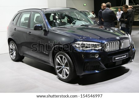 FRANKFURT - SEPT 10: BMW X5 sDrive 50i shown at the 65th IAA (Internationale Automobil Ausstellung) on September 10, 2013 in Frankfurt, Germany. - stock photo