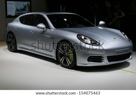 FRANKFURT - SEPT 10: Porsche Panamera S E-Hybrid shown at the 65th IAA (Internationale Automobil Ausstellung) on September 10, 2013 in Frankfurt, Germany. - stock photo