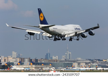 FRANKFURT - SEPTEMBER 17: Lufthansa Boeing 747-400 aircraft on approach on September 17, 2014 in Frankfurt. Lufthansa is the German flag carrier and Europe's largest airline. - stock photo