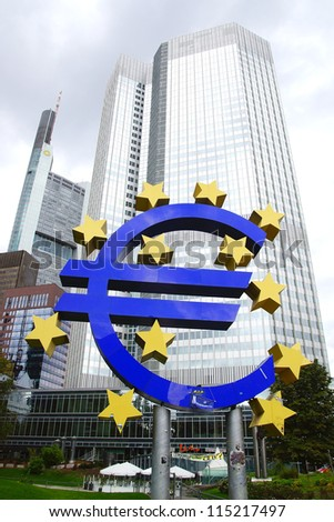 FRANKFURT - SEPTEMBER 25: The Famous Big Euro Sign at the European Central Bank. The bank was established by the Treaty of Amsterdam in 1998; September 25, 2012 in Frankfurt, Germany. - stock photo
