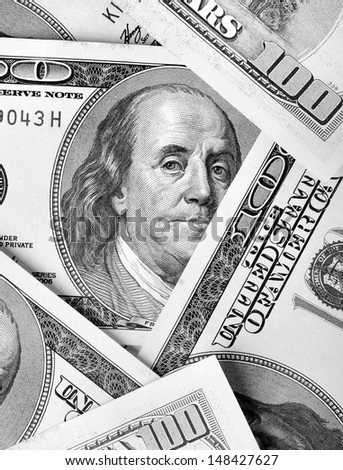 Franklin's portrait on dollar bills close-up - stock photo