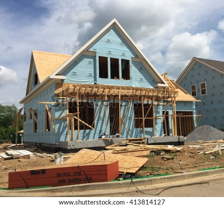 FRANKLIN, TN-APRIL 30, 2016:  New home under construction. The framing is nearly complete. - stock photo