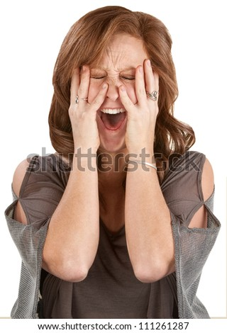 Frantic woman screaming with hands on face - stock photo