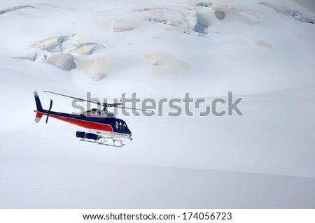FRANZ JOSEF GLACIER, NEW ZEALAND: DECEMBER 24, 2009: helicopter flight approaching Franz Josef Glacier, Westland, New Zealand  - stock photo