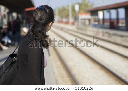 Frau wartet auf Zug - stock photo