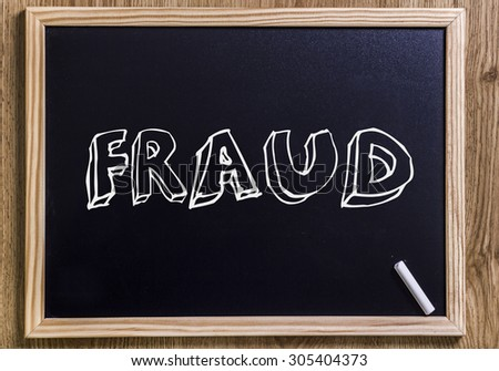 FRAUD - New chalkboard with outlined text - on wood - stock photo