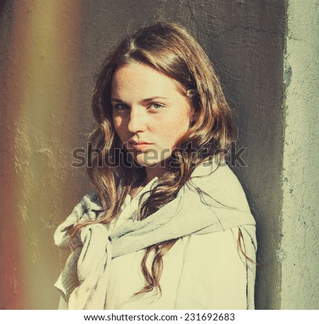 freckled hipster young beautiful woman street portrait  - stock photo