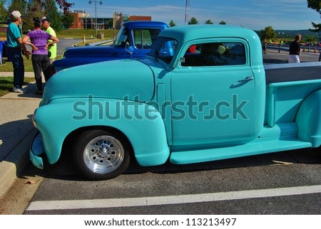 FREDERICK, MD- SEPTEMBER 16: Blue Vintage Ford Truck at a Car Show on Sept. 16, 2012 in Frederick , MD USA.  Alzheimer's Association Benefit Car Show at  Motor Vehicle Administration in Maryland. - stock photo
