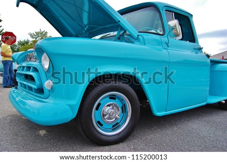 FREDERICK, MD- SEPTEMBER 16: Blue Vintage Ford Truck Front at a Car Show on Sept. 16, 2012 in Frederick , MD USA. Alzheimer's Association Benefit Car Show at Motor Vehicle Administration in Maryland. - stock photo