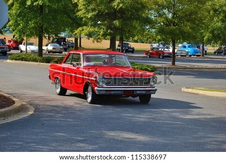 FREDERICK, MD- SEPTEMBER 16: 1950 Red Chevrolet 2 Door Sedan  on September 16, 2012 in Frederick , MD USA. Alzheimer's Association Benefit Car Show at Motor Vehicle Administration in Maryland. - stock photo