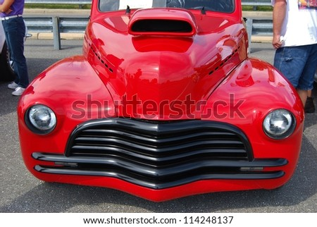 FREDERICK, MD- SEPTEMBER 16: 1941 Red Chevy Coupe on Sept. 16, 2012 in Frederick , MD USA. Alzheimer's Association Benefit Car Show at Motor Vehicle Administration in Maryland. - stock photo