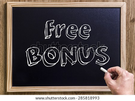 Free Bonus - New chalkboard with 3D outlined text - on wood - with hand - stock photo
