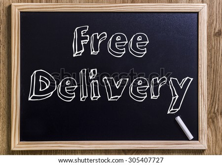 Free Delivery - New chalkboard with outlined text - on wood - stock photo