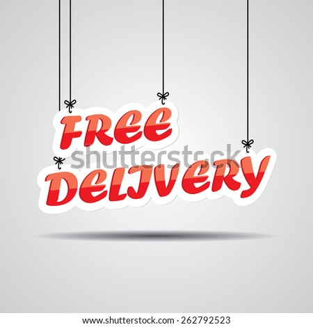 Free Delivery  Sign Hanging On Gray Background. - stock photo