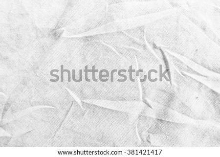Free form on white light gray cotton fabric sheet background texture - stock photo