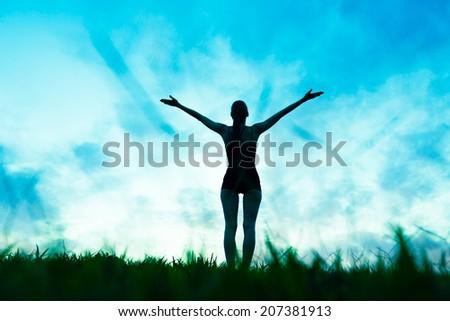 Free happy woman enjoying nature. Sunbeams. Enjoyment. Freedom concept. - stock photo