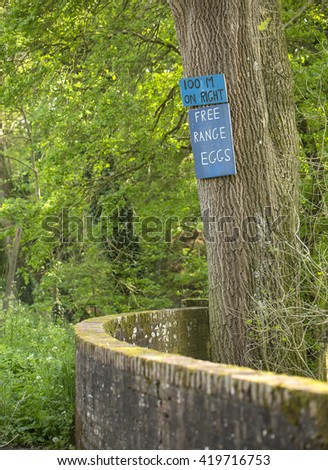 Free Range Eggs. Farmers put up signs to sell their wares to passing public on the country roads of England. This farmer is selling free range eggs. - stock photo