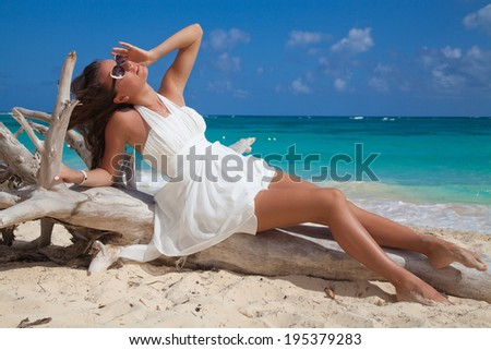 Free sexy woman in white summer dress enjoying nature on the exotic beach. Beauty girl outdoor. Freedom concept. - stock photo