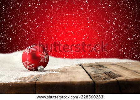 free space on table red ball and red wall  - stock photo