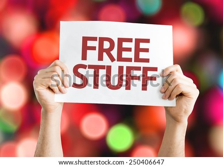 Free Stuff card with colorful background with defocused lights - stock photo