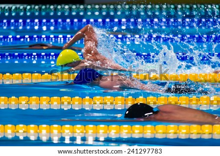 free style men  competition in swimming pool - stock photo