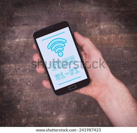 Free Wi-Fi on a mobile phone, vintage setting - stock photo