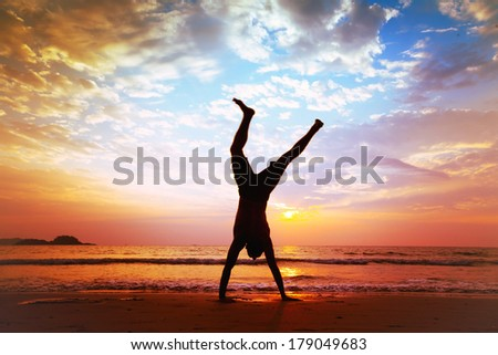 freedom and creativity, man jumping on the beach - stock photo