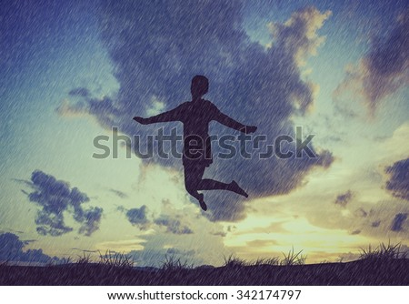 Freedom and Enjoyment concept - Happy lady jumping ,dancing with rain - stock photo