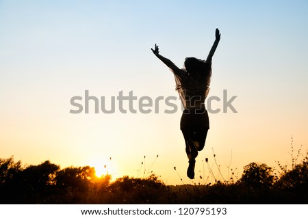 Freedom, beautiful girl jumping - stock photo