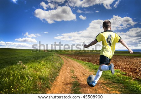 Freedom. Boy playing football - stock photo
